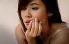 a woman holding her cheek
