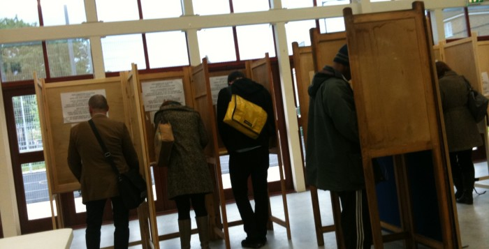 people voting at a polling place