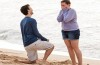 A man proposing, on the beach