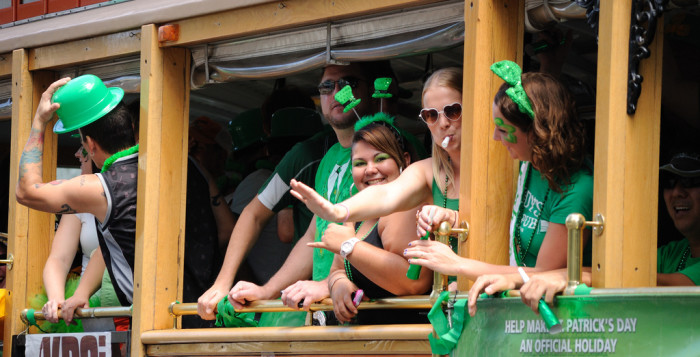 people on a trolley dressed for st. patrick's day