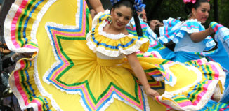 dancers dressed up in mexican dresses dancing