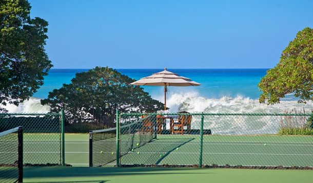 a tennis court by the ocean