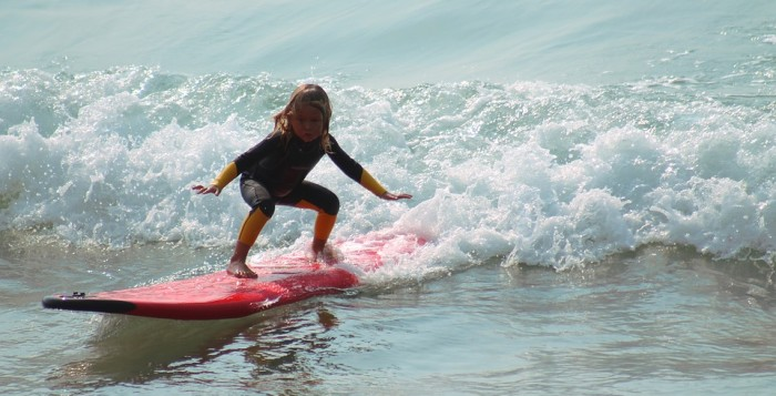 a young girl surfing