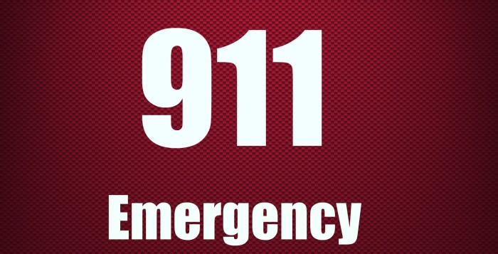 a sign saying 911 emergency
