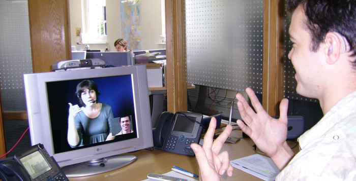 a deaf person using a video relay service
