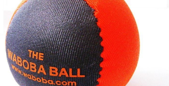 an orange and blue waboba ball