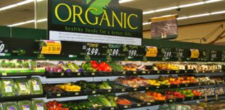 the organic section of a grocery store, featuring different foods