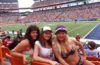 three girls at a football stadium