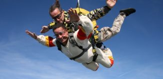 a tandem skydiving jump in mid-air