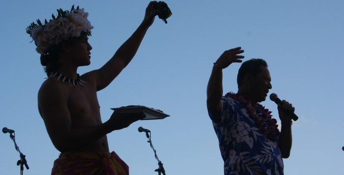 a hula dancer holding up food