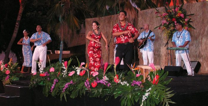hula dancers performing on a stage