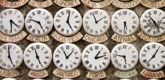 a wall of clocks