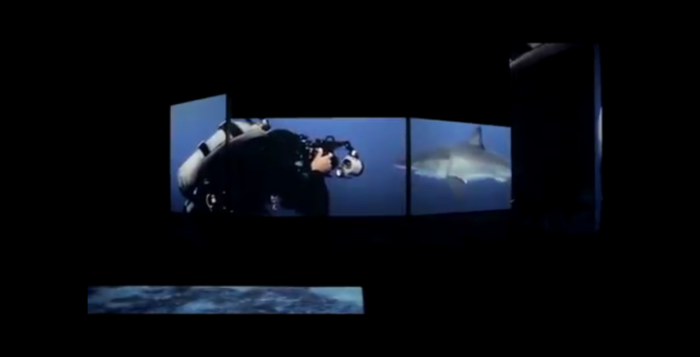 a scuba diver with a shark on a screen