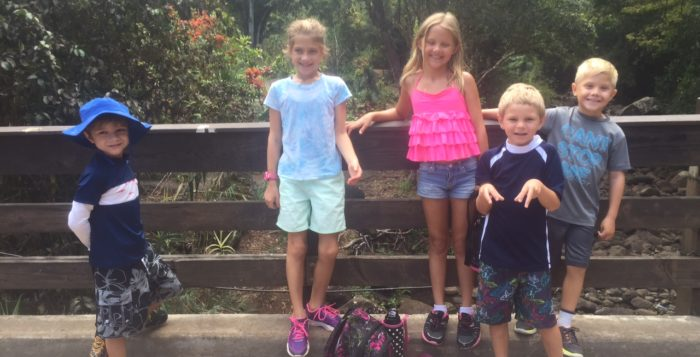 five children posing for a picture at waimea canyon