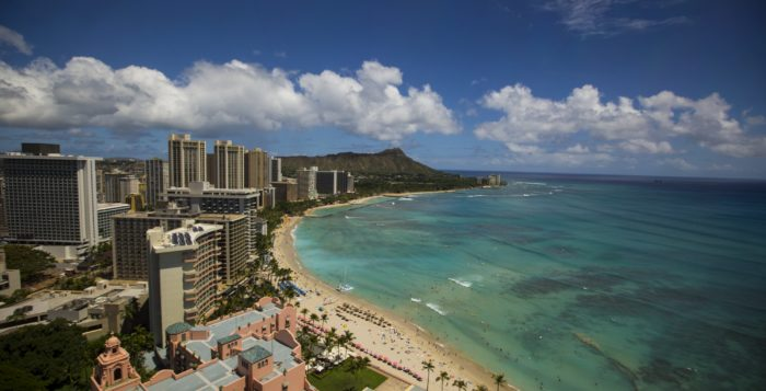 aerial shot of waikiki beach with buildings and diamond head