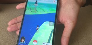pokemon app in palm of hand