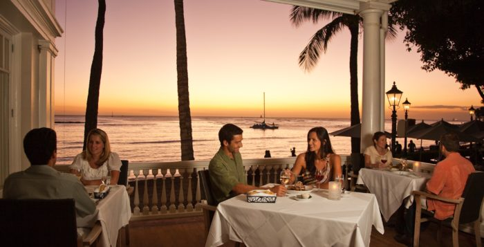 a couple eating in a restaurant in hawaii