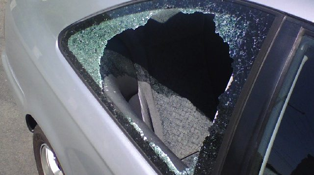 a broken window on a car