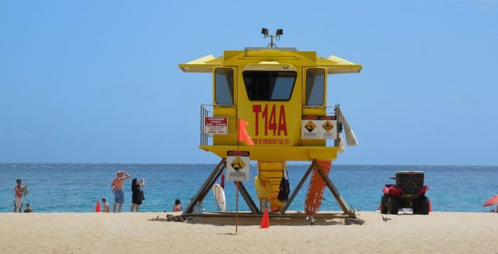a yellow lifeguard stand on a beach