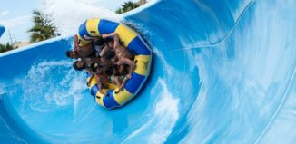 a group of people on a raft on a waterslide