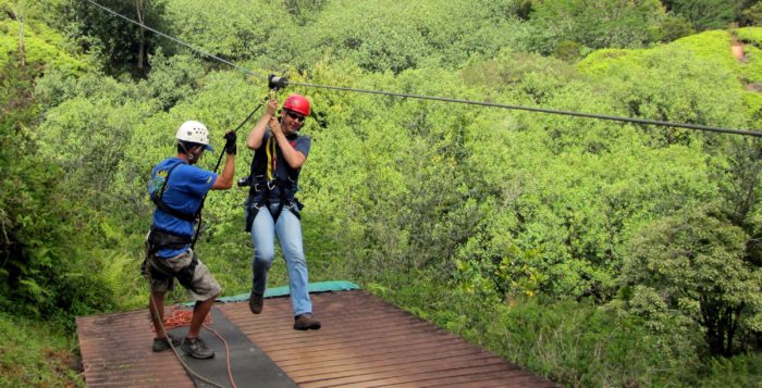 a man getting ready to zip line