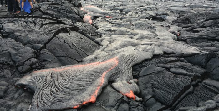 red lava flowing on the big island of hawaii