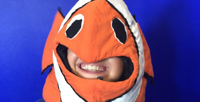 a girl in a fish costume