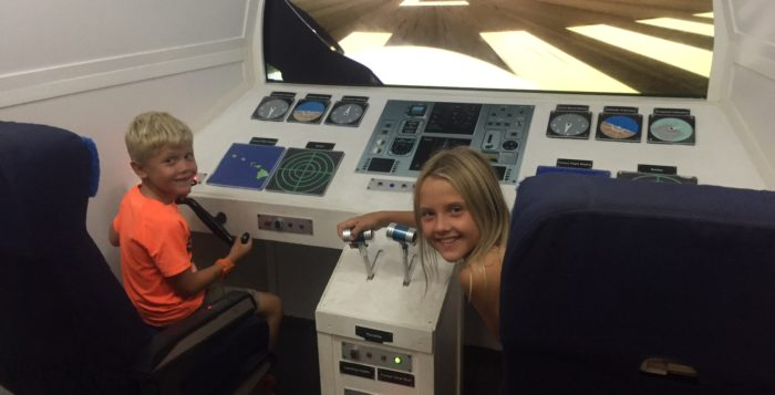 two children in the cockpit of a plane replica