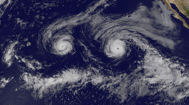 a satellite image of two hurricanes