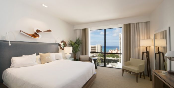 a guestroom at the new hyatt centric waikiki with a bed