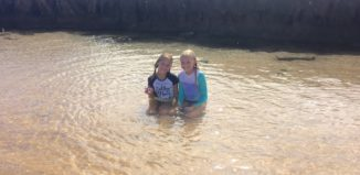 two children in a tide pool