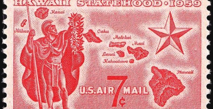 a stamp with hawaii symbols
