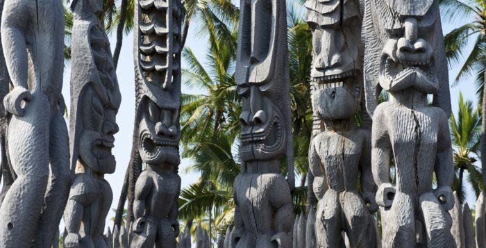 the kii statues at Puuhonua O Honaunau National Historical Park