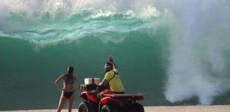 a lifeguard conversing with a beachgoer