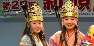two girls dressed in okinawan clothes
