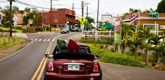 a car driving through haleiwa on oahu