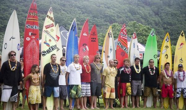 surfers standing with surfboards