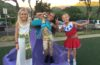 three girls dressed in halloween costumes
