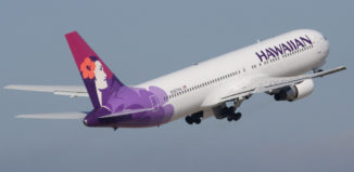 a hawaiian airlines jet in the sky