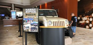 a jeep tour display with a full-sized jeep