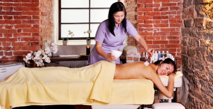 a woman giving another woman a massage