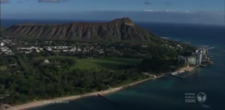 a screenshot of a travel video featuring diamond head
