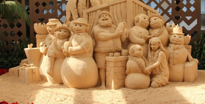 a sand sculpture featuring snowmen