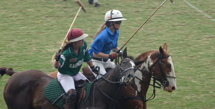two women playing polo