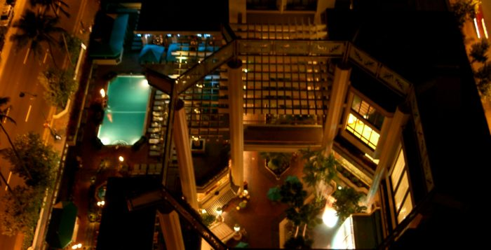 Looking down on Hyatt Regency Waikiki pool from rooftop