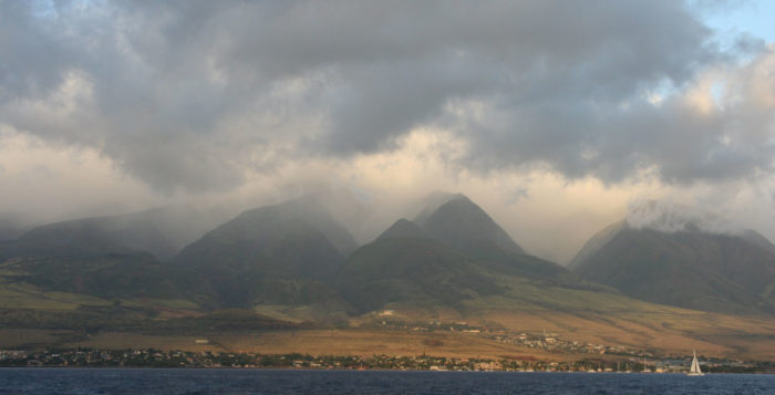 rain falling over mountains in hawaii
