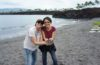 Couple holding balk sand at beach