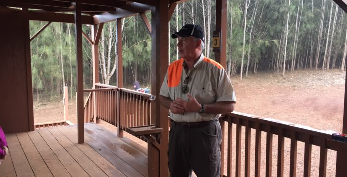 an instructor at a clay shooting range