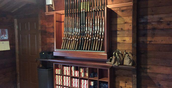 guns on a shelf inside a cabin