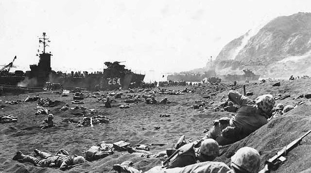 marines laying on the ground during the battle at iwo jima